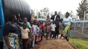 Kids examine the new water tank