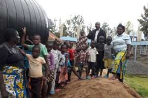 Kids examine the new water tank